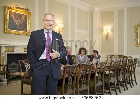 Caucasian businessman standing at meeting table