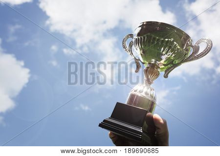 Celebrating with trophy award for success or first place sporting championship win