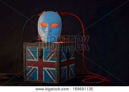 Concept of terrorism.England flag box, jumper cables and mask on dark background