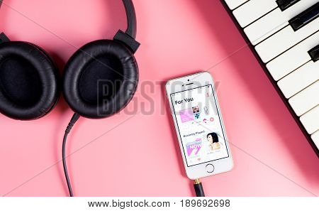 Tokyo Japan - May 4 2017: Musician is listening to Apple Music on iPhone.