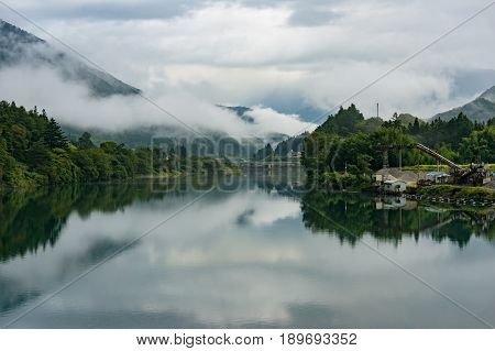 Japanese Countryside Landscape With Kiso River And Fog Over Mountains