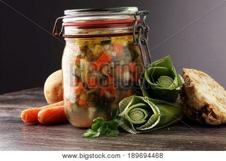 Jar With Variety Of Pickled Vegetables. Carrots, Field Garlic, Parsley In Glas. Preserved Food
