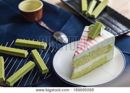 Closeup Delicious Sweet Dessert Fresh Green Tea Cake With Fresh Matcha Decoration