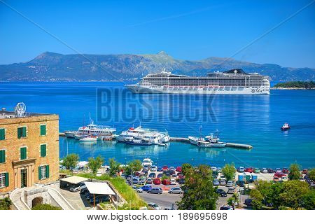 CORFU ISLAND, GREECE, JUN,06, 2014: View on giant amazing white touristic passenger liner vip yachts in Ionian Sea. MSC FANTASIA cruise liners. Greece islands holidays tours Mediterranean Sea cruises