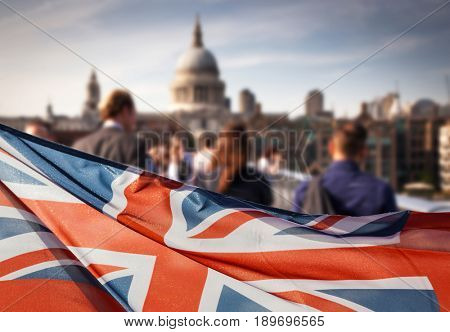 union jack flag and people walking on Millennium bridge at St Paul's cathedral - general elections, London, UK