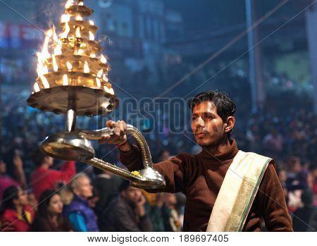 VARANASI, INDIA - JANUARY 3, 2016: Indian Brahmin conducts religious Ganga Maha Aarti ceremony (fire puja) at Dashashwamedh Ghat