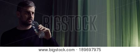 Widower Drinking Alcohol From Bottle