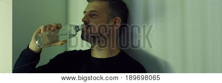 Drinker With Bottle Of Vodka