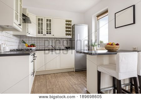 Modern Kitchen With Painting On The Wall