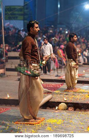 VARANASI INDIA - JANUARY 3, 2016: Indian Brahmins conducts religious Ganga Maha Aarti ceremony (fire puja) at Dashashwamedh Ghat
