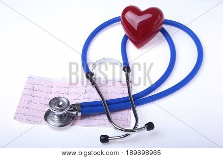 medical stethoscope, RX prescription and red heart isolated on white background. selective focus