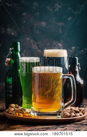 Glasses with different sorts of craft beer on wooden table