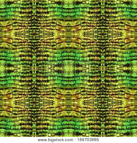 Abstract seamless pattern with snake leather. Green, brown and yellow background with scales resembling reptile skin