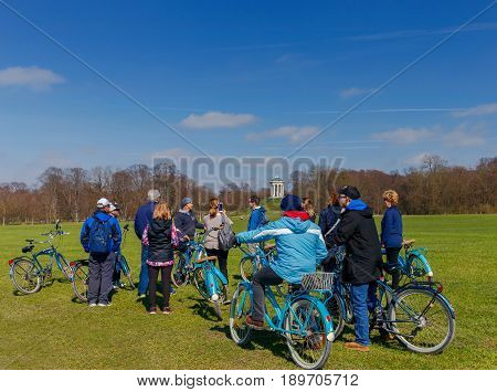 Munich, Germany - March 23, 2017: Townspeople and visitors of the city in English park. Favorite place for recreation and promenade. Munich. Bavaria. Germany.