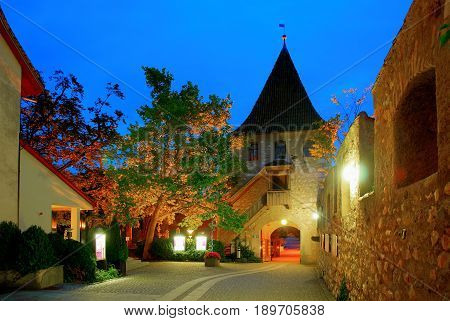 Night view on castle Schloss Laufen patio, restaurant, tower. Castle on Rhainfall waterfall biggest in Europe. European castles. Swiss castle holidays vacations famous sightseeing tours