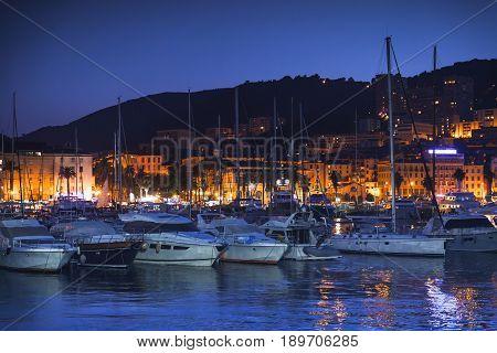 Pleasure Yachts And Motor Boats At Night