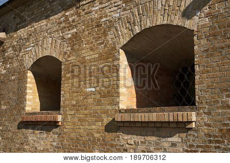 Embrasures for artillery in the brick wall of the caponier. Fragment of the fortification of the nineteenth century The Kiev Fortress