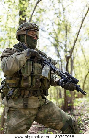 Military intelligence officer on assignment in woods during day