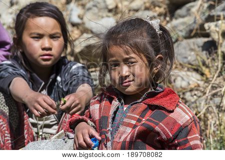HIMALAYAS ANNAPURNA REGION NEPAL - OCTOBER 17 2016 : Poor children on the street in Himalayan village Nepal