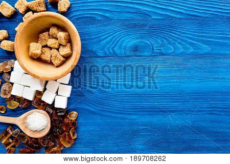 Lumps Of Sugar In Bowls On Blue Table Background Top View Space For Text