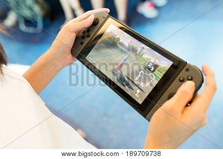 Hong Kong, 19 May 2017 -: Hand holding Nintendo Switch