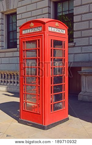 LONDON, ENGLAND - May 24,2017: traditional red telephone booth in London, red public phone - a symbol of the city, London, UK