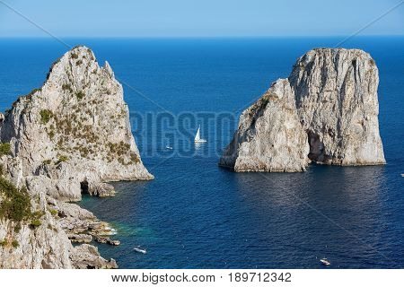 amazing Faraglioni cliffs panorama with the Tyrrhenian sea in background, Capri island, Campania region, Italy