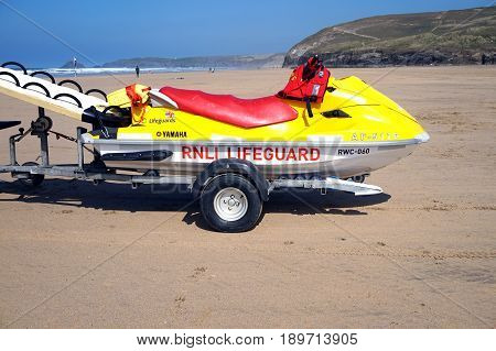 Newquay, Cornwall, Uk - April 7 2017: Rnli Lifeguard Jetski On A Trailer On A Surfing Beach In Newqu