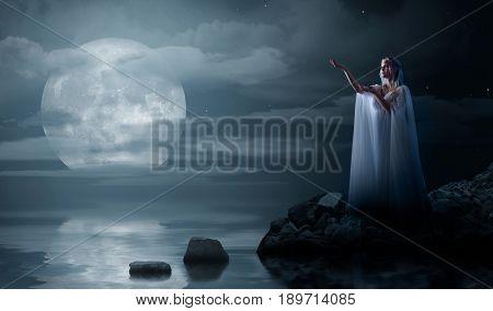 Young elven girl on sea coast