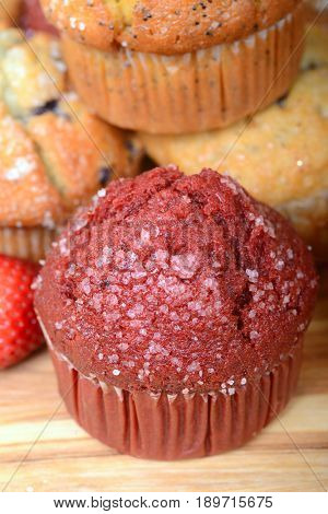 Delicious Red Velvet muffin surrounded by other types of muffins