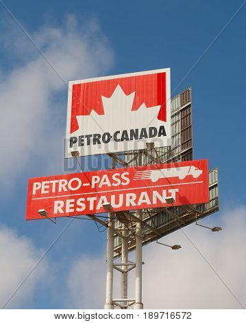 GREAT VILLAGE CANADA - JUNE 02 2017: Petro-Canada restaurant sign. Petro-Canada was an oil and gas industry crown corporation of Canada. The company merged with Suncor Energy In 2009.