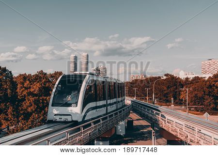 High-speed overground elevated monorail junction with contemporary trainand two twins skyscrapers with