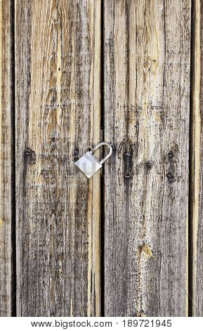 Wooden Door Locked With A Padlock