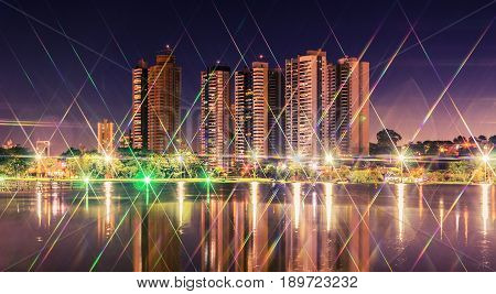 Night At A Lake Of A Park With The City On Background