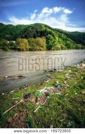Plastic Contamination into Nature. Garbage and bottles floating on water. Environmental pollution in Georgia. Garbage in the water of river.