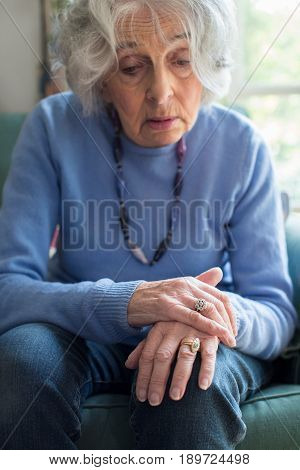 Concerned Senior Woman Suffering With Parkinsons Diesease