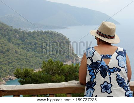 An english tourist looking out over the beautiful scenic bay at Kabak in Turkey, 2017