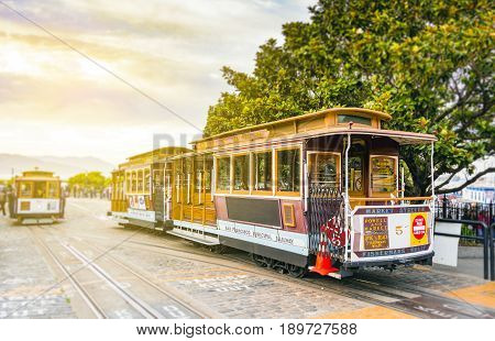 traditional San Francisco cable car standing at the terminus in Fisherman Wharf with blurred background