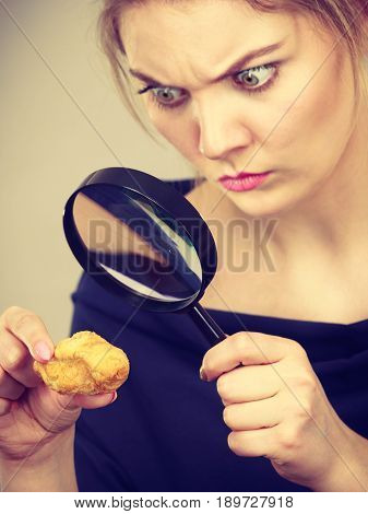 Woman Holding Magnifying Glass Investigating Bread