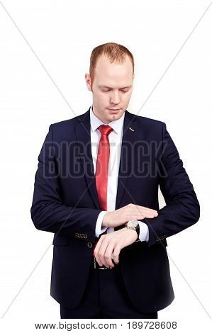businessman in suit and red tie checking time on his wrist watch. mens hand with a watch, watch on a man's hand, the fees of the groom, wedding preparation, preparation for work, man's style on white background, average plan.