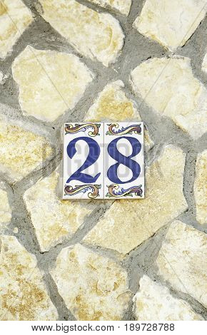 Number Twenty-eighth In A Stone Wall
