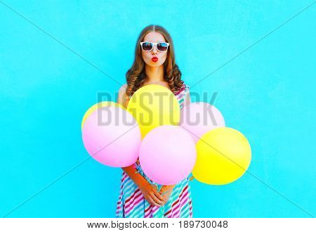 Fashion Woman Blowing Lips Making Kiss An Air Colorful Balloons On A Blue Background