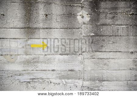 Yellow Arrow On Cement Wall