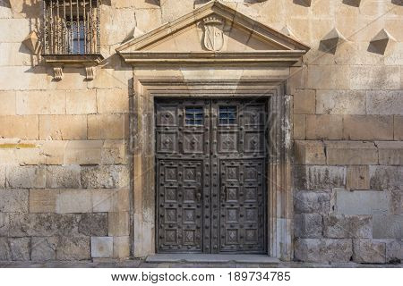 Ancient Wooden Door Of The Palace Of Dukes Of Infantry In Guadalajara, Spain
