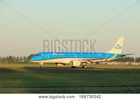 Amsterdam the Netherlands - June 2nd 2017: PH-EXE KLM Cityhopper Embraer ERJ-190STD taking off from Polderbaan Runway Amsterdam Airport Schiphol