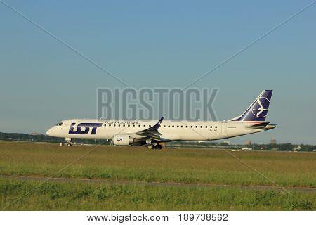 Amsterdam the Netherlands - June 1st 2017: SP-LND LOT - Polish Airlines Embraer ERJ-195LR taking off from Polderbaan Runway Amsterdam Airport Schiphol