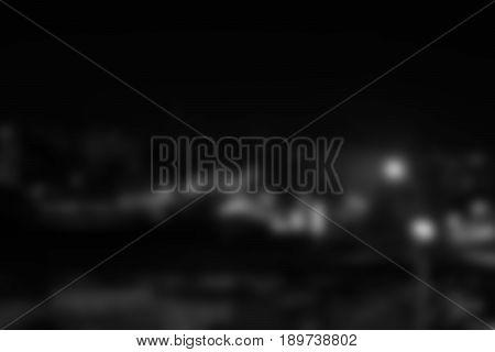 Blurred dark background with light spots. Rectangular photo.