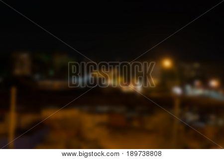 Blurred photo of the night city. Horizontal rectangular background.
