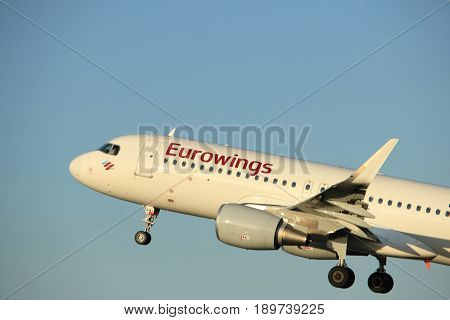 Amsterdam the Netherlands - June 1st 2017: D-AEWJ Eurowings Airbus A320-200 taking off from Polderbaan Runway Amsterdam Airport Schiphol