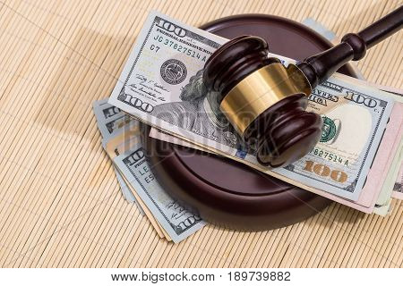 Us Money  With Wooden Judges Hammer On Table, Top View